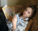 A girl relaxes while reading