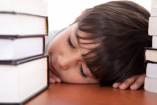 Picture of sleeping boy with books