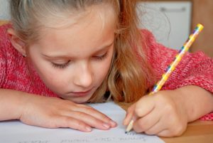 young girl with pencil