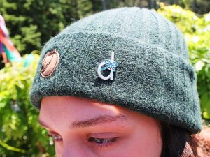 hat with dyslexia pin